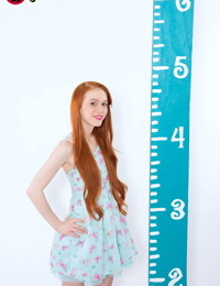Petite cute redhead Dolly Little spreads topless in cotton panties & socks