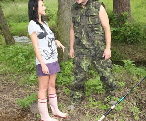 Dark haired teen is stripped and fucked in the woods by a man in fatigues