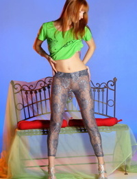 Slender redhead Alexana peels off her yoga pants to spread her long legs wide
