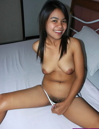 Thai girl creams her natural pussy while getting naked for the first time