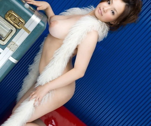 Japanese piece of baggage Rika Aiuchi uncovers fat tits while posing solo