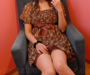 Japanese teen with a pretty face shows her legs relative to a short glad rags together with heels