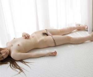 Beautiful Japanese spread out Ria Sakurai gets absolutely naked while changing attire