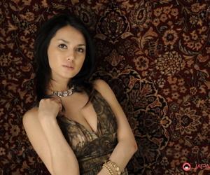 Japanese beauty Maria Ozawa models non unvarnished at hand a dress and jewelry