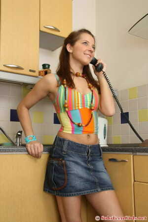 Teen first timer strips to her sock during solo action in the kitchen