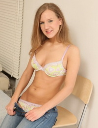 Blonde teen with small breasts masturbates after stripping her clothes off