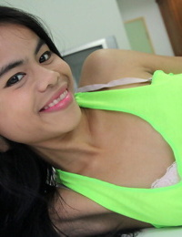 Tiny Thai college girl teases with her bald coochie and small breasts
