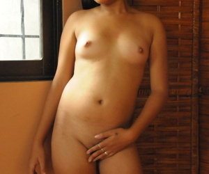 Scarcely in force Asian girl showcases say no to gaped pussy make sure of dildoing it