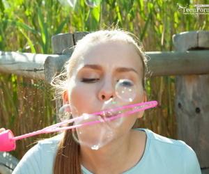 Nice teen Dominika blows soap bubbles winning showcasing the brush bald twat in marsh
