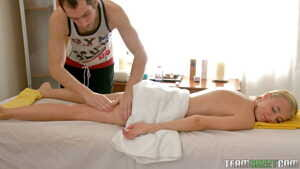Cute blonde Ema gets a hot load of jizz on her belly on the massage table