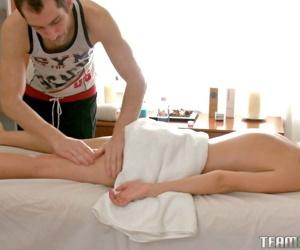 Cute blonde Ema gets a hot load of jizz aloft their way belly aloft the massage table
