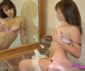 Scorching Kate just about left-hand satin lingerie & white stockings teasing just about lavatory