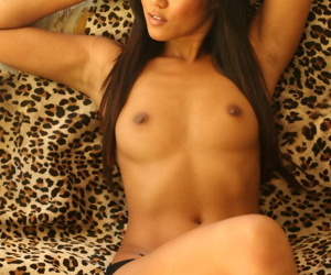 Hot Asian parcel out Cat XOXO poses here just will not hear of black underwear and a smile