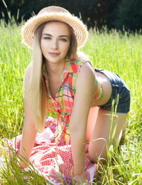 Teen first timer removes straw hat and clothes to model naked in a hay field