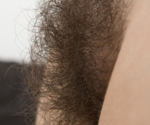 Young first timer everywhere jet-black hair wears a smile while unveiling her hairy undercover