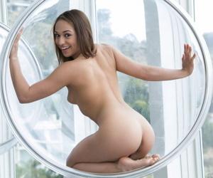 Pulling amateur happily removes her X skivvies to observe naked in the air the window