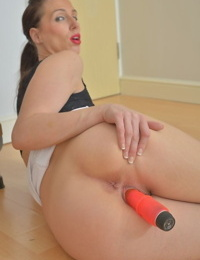 Tammie loves the stiff toy cock in her pierced pussy and ass