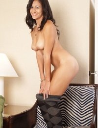 Playful chick Lily Charms demonstrates tits and pussy alone at home