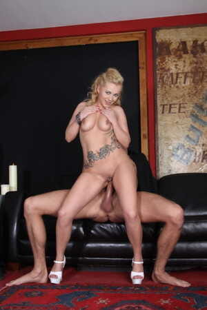 German inked bimbo Curly Ann fucked and covered in jizz on the leather sofa