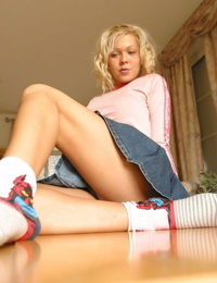 Hot blonde teen takes off her cotton underwear on the coffee table