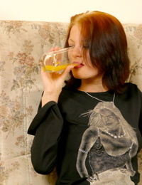 Young redhead downs some OJ before seducing and fucking a man friend