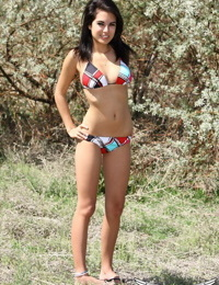 Dark haired teen unveils her perky tits before standing butt naked outdoors