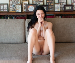 Dark haired knockout Jolie confidently unleashes their way great tits as A she disrobes