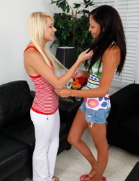 Lesbian girls Sky Light & Ariana Marie tongue kiss after baring small boobs