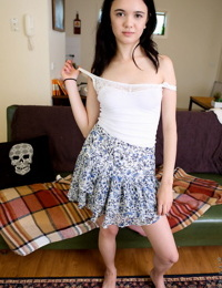 Darling little Lily Rei lifts up her short skirt and fingers her spread pussy