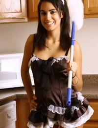 Dark haired female Rachel models lingerie after removing her maid unmiform