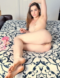Fair skinned solo girl Kasey Warner spread wide open to show her trimmed pussy