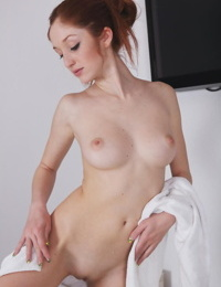 Hot redhead Michelle H undresses to show hard nipples & shaved cunt in bath