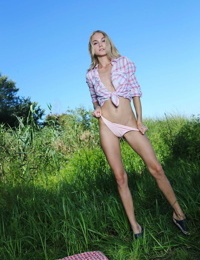 Young blonde girl Jane F strips naked on the bank of a river