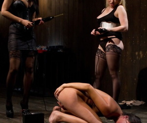 Dark haired girl is forced into unnatural lesbian sex acts by kinky chicks