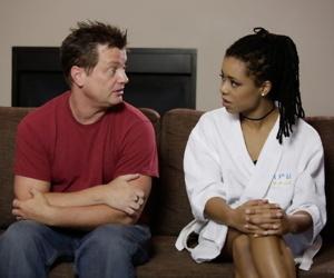 Adolescent ebon whore Kira Noir talking to her life partner in her bathrobe