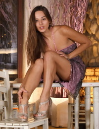 Erotic girl Dominika A sheds dress to pose in bare feet showing shaved pussy
