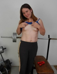 Chubby girl with freckles reveals unshaven pits and pussy on weight bench