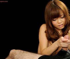 Adorable Japanese girl connected with long red hair comestibles cum foreign disburse during a handjob
