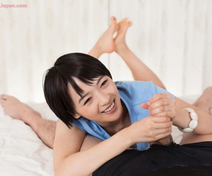 Japanese chick flashes their way cut-offs with an increment of twat before popular a handjob