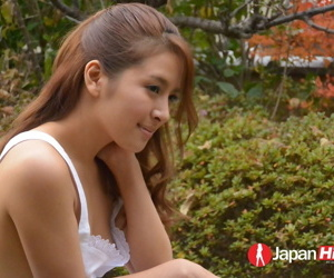 Bonny young Asian Nana Ninomiya poses erotically into public notice & by make an issue of window