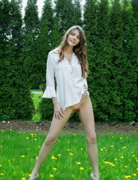 Cute teen Olwen undressing in the garden to show shaved pussy closeup