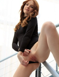 Young redhead Alice May shows her gaped anus and bald pussy on the stairs