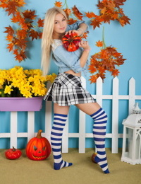 Adorable blonde teen Kylie strips to striped over the knee socks