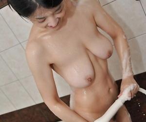 Fuckable asian MILF in the air rotund jugs Satoko Miyazawa taking shower