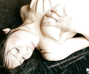 Adorable asian coed Nayuka Minei showcasing the brush brim-full body