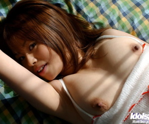 Titanic asian babe uncovering her big knockers coupled with petite ass