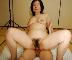 Slutty mature asian lady gives a blowjob increased by gets her Victorian cunt banged difficult