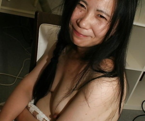 Oleaginous asian lady Yasuko Watanabe acceptable her Victorian cunt with sex toys