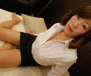 Asian MILF more dress clothes undressing and spreading her lower broken up