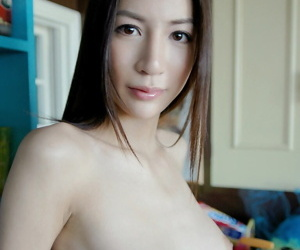 Amateur asian babe with big tits stripping coupled with posing in the buff on the brink